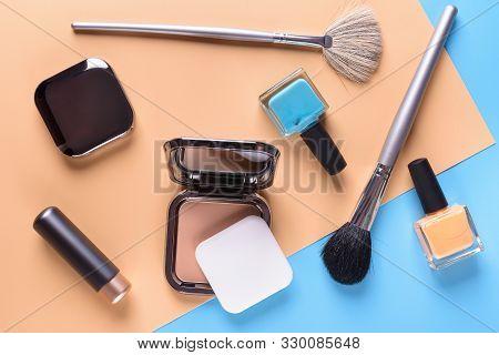 Flat View Of Cosmetics - Lipstic, Face-powder, Brushes, Nail Polish