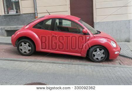 Red Volkswagen New Beetle
