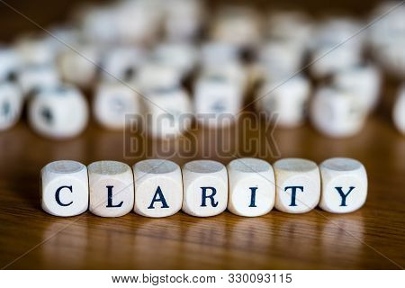 Clarity Written In German With Wooden Cubes