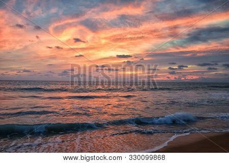 Phuket Beach Sunset, Colorful Cloudy Twilight Sky Reflecting On The Sand Gazing At The Indian Ocean,