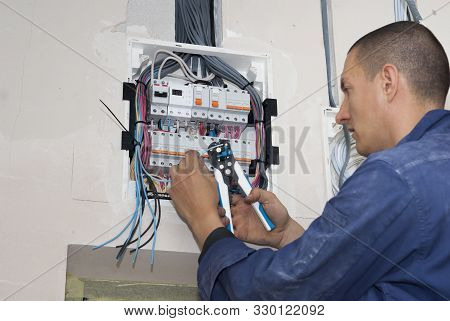 Open Electrical Junction Box And Wires On The Ceiling