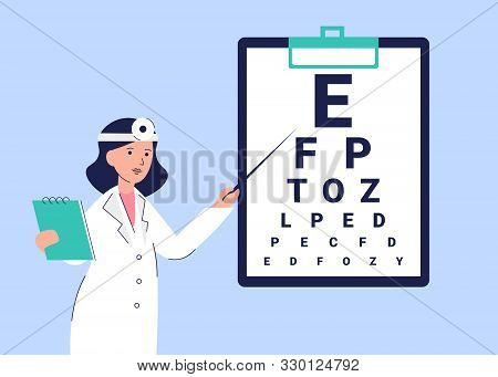Woman Oculist In A White Coat Shows Eye Test Chart. Vision Examon On Clipboard. Female Specialists O