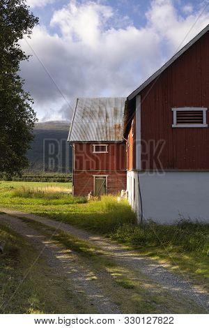 Falured Painted Farmbuilding Near Lesja In The Norwegian Region Gudbrandsdalen