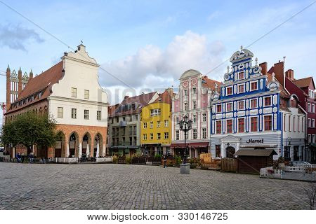Szczecin, Poland - October 26, 2019: Old Town Hall And Colorful Historic Facades At The Hay Market I