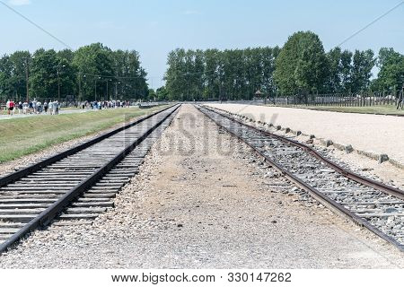 Brzezinka, Poland - July 28, 2019: View Of Railway Tracks At Former German Nazi Concentration And Ex