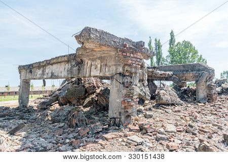 Brzezinka, Poland - July 28, 2019: View Of Ruins Of Gas Chamber And Crematorium Ii At Auschwitz-birk