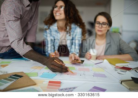 Creative Business Team Working On Design Project Focus On Table With Roadmap And Colorful Stickie No