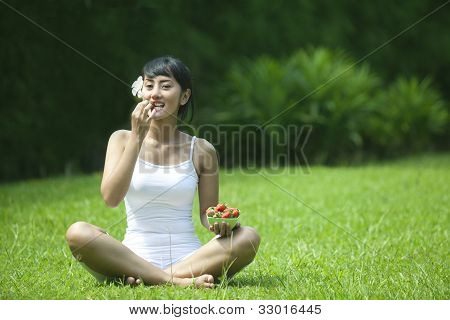 Healthy Lifestyle: Woman With Strawberry