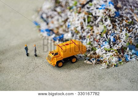 Garbage Truck Toy Model And Workers Dumping The Garbage, Close-up