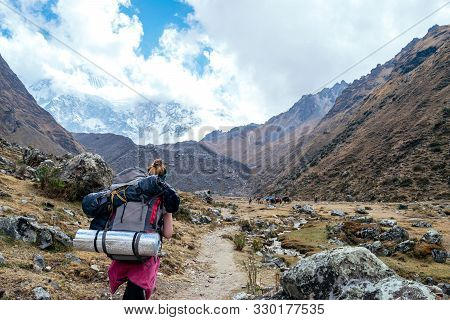 Young Woman Looking At The Panoramic View During The Walk Between The Mountains In Salkantay - Cusco