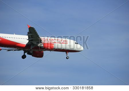Amsterdam The Netherlands - April, 19th 2018: Oe-log Laudamotion Airbus A320-200 On Final Approach T