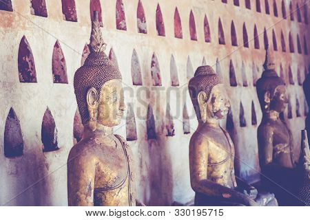 poster of Laos, Old Buddha image in Wat Sisaket popular place to visit in Vientiane city and landmark, Old buddha statue in laos (Vientiane, Laos)