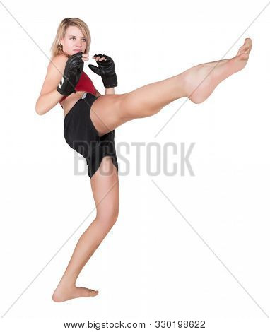 Caucasian woman training is a kickboxing outfit for mixed martial arts