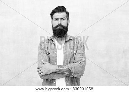 Masculinity And Male Beauty Concept. Hipster With Beard And Mustache Wear Denim Shirt. Well Groomed