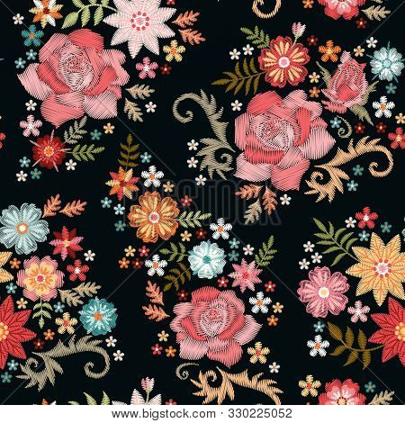 Embroidery Seamless Pattern With Beautiful Flowers On Black Background. Fashion Design For Fabric, T