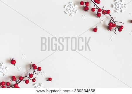 Christmas Or Winter Composition. Snowflakes And Red Berries On Gray Background. Christmas, Winter, N