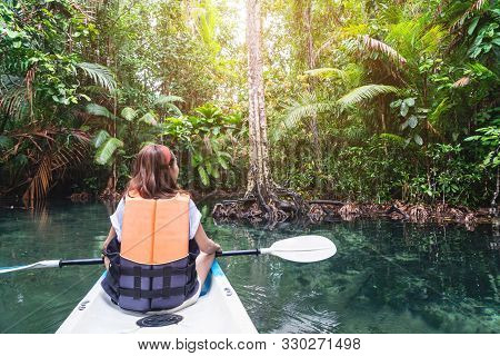 Young Woman Tourist Paddling The Kayak At Klong Root In Krabi, Thailand