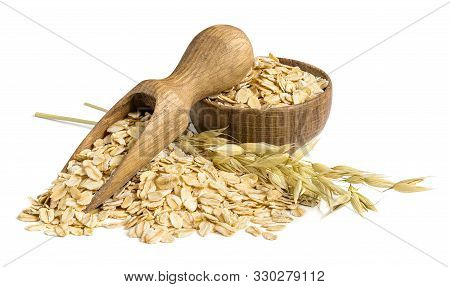 Pile Of Oat Flakes With Wooden Scoop, Small Bowl And Oat Plant Isolated On White.