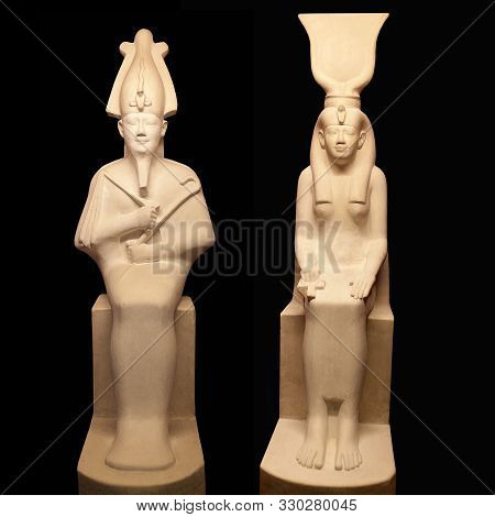 Statues Of Egyptian Gods Osiris And Isis On Black Backgroung. Osiris Is Lord Of The Death And Resurr