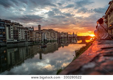 Sunset View Over Arno River In Florence, Italy. Florence Architecture. Many People See The Sunset Ov