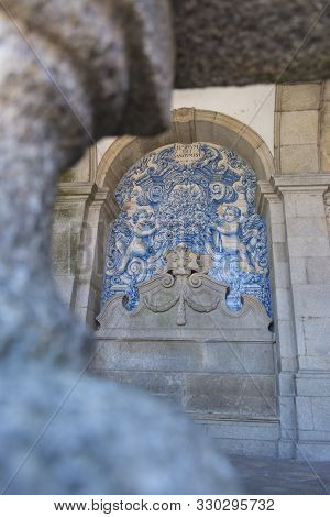Porto, Portugal - July 21, 2017: Painted Tiles From The Cathedral Of Porto, Through The Pillars Of T