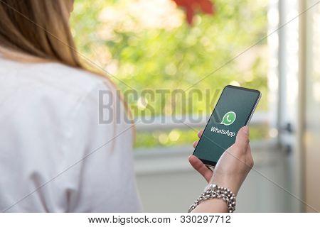 Rosario, Santa Fe, Argentina - October 25, 2019: Whatsapp Logotype On The Screen Of Cell Phone. Youn