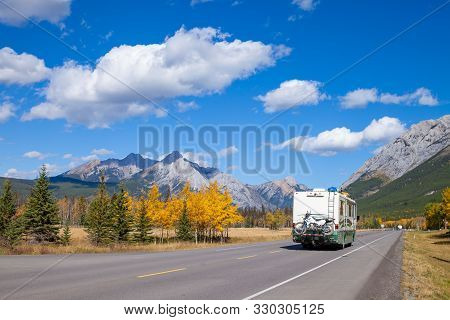 An Rv Aon The Highway Through The Canadian Rocky Mountains In Kananaskis, Alberta, Canada During The