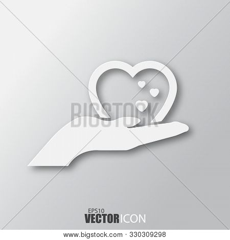 Heart In Hand Icon In White Style With Shadow Isolated On Grey Background.