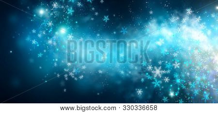 Winter Christmas and New Year glittering snow flakes swirl on black bokeh background, backdrop with sparkling blue stars, holiday garland, magic glowing stars, lights. Abstract Glitter Blinking sparks