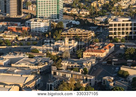 Burbank, California, USA - October 25, 2019:  Early morning aerial view of Burbank Media District architecture and outdoor sets at Warner Bros studio lot near Los Angeles.