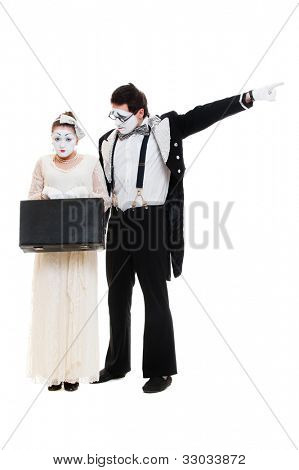 studio shot of mimes with suitcase. isolated on white