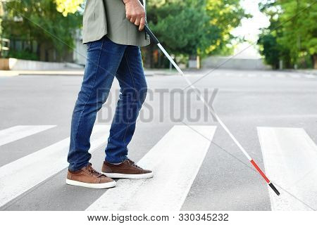 Blind Person With White Cane Crossing Street In City, Closeup