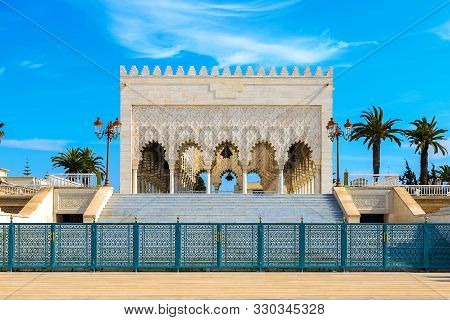 View Of The Snow-white Mausoleum Of Mohammed V Against The Blue Sky. Rabat, Morocco