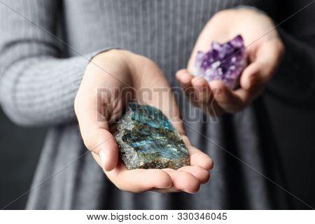 Woman Holding Amethyst And Labradorite Gemstones, Closeup