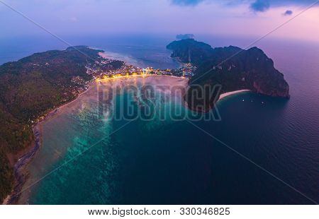 Aerial View Of Phi Phi, Maya Beach With Blue Turquoise Seawater, Mountain Hills, And Tropical Green