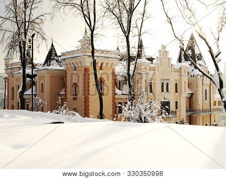 Winter Tale. New Year Celebration. Beautiful Building In Castle Style In Winter. Winter View Of Snow