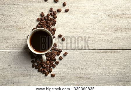 Brown Coffee Beans And A Cup Of Hot Coffee Placed On A Wooden Table Ready To Drink Coffee Time To Re