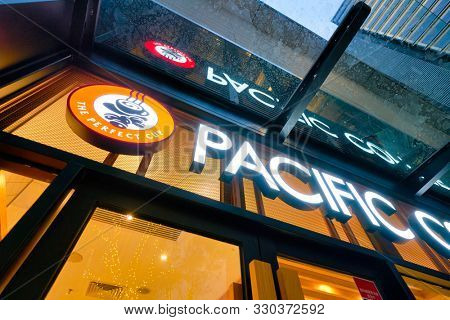 SHENZHEN, CHINA - APRIL 15, 2019: Pacific Coffee sign over coffeeshop entrance in Shenzhen.
