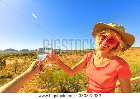 Uluru, Northern Territory, Australia - Aug 25, 2019: Smiling Tourist Woman Celebrating Mount Olga Ro
