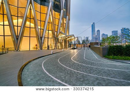 SHENZHEN, CHINA - APRIL 15, 2019: street level view of China Resources Shenzhen Bay with Shenzhen in the background at dusk.