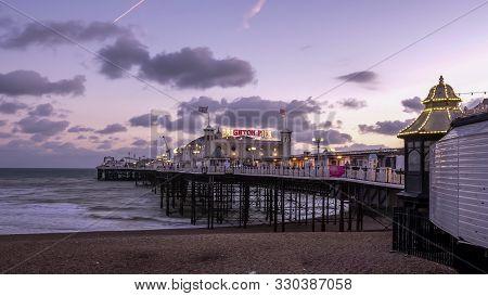 Brighton, England- October, 4 2017: A Sunset Shot Of Brighton Pier At Brighton Beach