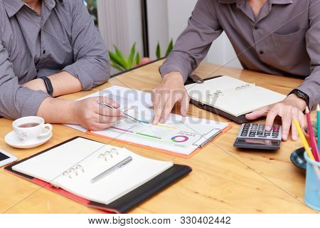Small And Medium Enterprise Business Concept Of ,businessman Presenting Investment Plan To His Partn