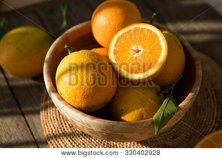 Oranges In Bowl.  Lots Of Fresh Oranges Fruits Plucked From Branch Of Orange Tree.