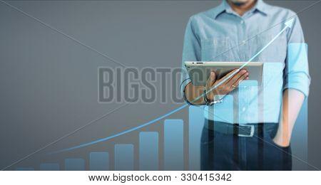Businessman Using Digital Tablet In Hand.business Idea