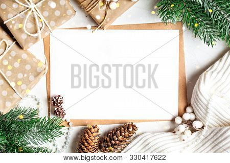 Merry Christmas And Happy New Year. Mockup With Postcard And Branches Of A Christmas Tree On White B