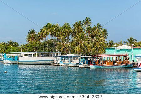 Himmafushi, Maldives - November 18, 2017: Boats Moored To The Transport Pier At Himmafushi Island, M