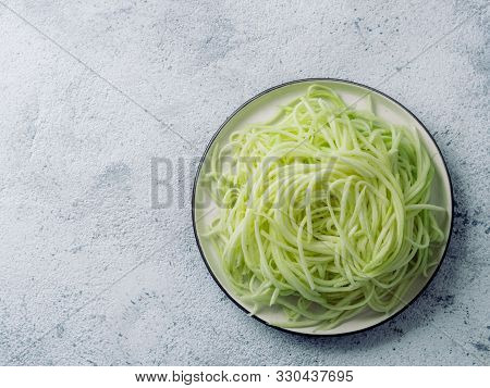 Zucchini Noodles On Plate. Vegetable Noodles - Green Zoodles Or Courgette Spaghetti On Plate Over Gr