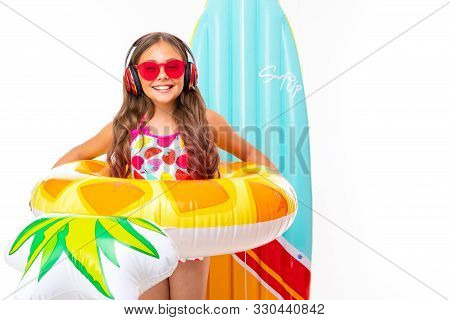 Baby In A Swimsuit With A Wide Smile On His Face, Summer Vacation Concept, Isolated White Background