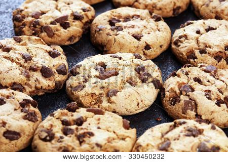 Chocolate Cookies On Wooden Table. Chocolate Chip Cookies Shot On Table