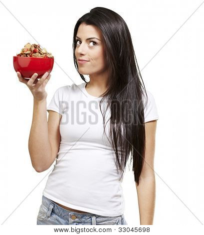 woman holding a delicious red breaksfast bowl against a white background